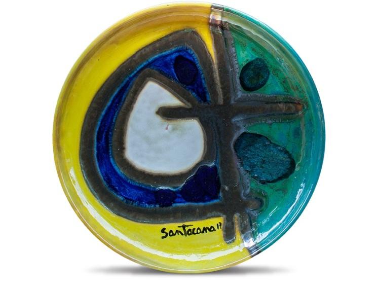 Plato de cerámica esmaltado con pigmentos, óxidos metálicos y vidrios fundidos